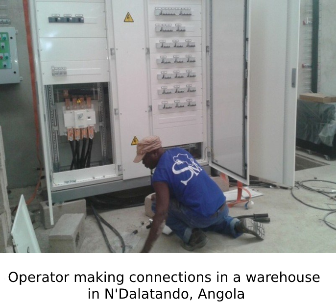 Operator making connections in a warehouse in N'Dalatando, Angola